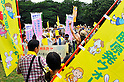Tokyo, Japan - June 17: People gathered against nuclear power plants in Japan at Inokashira Park, Mitaka, Tokyo, Japan on June 17, 2012. As Japanese Government decided to restart Oi Nuclear Power Plants No.3 and 4 in Fukui, people spoke up against the restart throughout the nation. .