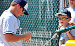 15 July 2010: Vermont Lake Monsters' pitcher Shane McCatty signs an autograph for a young fan  prior to a game against the Aberdeen IronBirds at Centennial Field in Burlington, Vermont. The Lake Monsters rallied in the bottom of the 9th inning to defeat the IronBirds 7-6 notching their league leading 20th win of the 2010 NY Penn League season. Mandatory Credit: Ed Wolfstein Photo