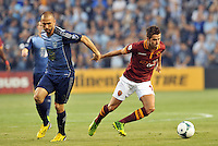 Sporting Park, Kansas City, Kansas, July 31 2013<br /> Miralem Pjanic (15) midfield AS Roma moves away from Marco Di Vaio.<br /> MLS All-Stars were defeated 3-1 by AS Roma at Sporting Park, Kansas City, KS in the 2013 AT &amp; T All-Star game.