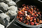 Five berry crumble cooking in Dutch oven over charcoal. Gary Butterfield and Dale Beam, members of the Puget Sound Dutch Oven Society teach classes in how to cook a variety of food and deserts in Dutch Ovens using charcoal briquettes.  Jim Bryant Photo. ©2010. All Rights Reserved.