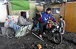 Arden Dasi, connecting his motorcycle and recycling cart, lived under a bridge in a Roma settlement in Belgrade, Serbia, when this photo was taken in February 2012. He and his family are refugees from Kosovo. The families that lived here, most of whom survive from recycling cardboard and other materials, were forcibly evicted in April 2012. Many were moved into metal shipping containers on the edge of Belgrade..