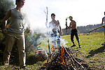 Patients in a rehabilitation program for heroin addiction operated by the NGO Rosa Vetrov tend to the campfire in Kazan, Russia, on Wednesday, September 26, 2007. The dozen patients in the free three-month program take a weekly field trip to a nearby lake, where they learn play soccer, have group therapy sessions, and generally learn how to relax and have fun without using drugs.