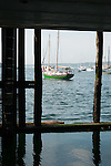 Sailboat viewed from under State Pier, Gloucester, MA