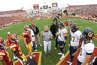 California captains' Chris Guarnero, Cameron Jordan, Mike Mohamed and Kevin Riley and USC captains watch referee Jack Folliard tosses a coin before the game against USC at LA Memorial Coliseum in Los Angeles, California.  USC defeated California, 48-14.