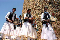 Libya     Nalut ..Berber granary with Ghorfas at Ksarr Qasr-al-Hadj Nafusah Mountains Libya .Folk  musical group