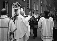 Episcopal Ordination Of Desmond Connell. (R74).1988..06.03.1988..03.06.1988..6th March 1988..Following the death of Archbishop Kevin McNamara in April '87, Pope John Paul II surprisingly nominated Desmond Connell for the position of Archbishop of Dublin. The ordination of Dr Connell took place at the Pro-Cathedral in Dublin...Image shows the Archbishop of Dublin, Desmond Connell, blessing the crowds as he makes his way back to Holy Cross College, Clonliffe.