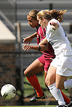 02 October 2011: Virginia Tech's Jazmine Reeves (left) and Duke's Maddy Haller (18). The Duke University Blue Devils defeated the Virginia Tech Hokies 1-0 at Koskinen Stadium in Durham, North Carolina in an NCAA Division I Women's Soccer game.