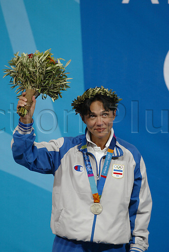 15 August 2004: Silver Medalist Jasna Sekaric (SCG) celebrates on the podium after the Women's 10m Air Pistol Final, Markopoulo Olympic shooting centre, 2004 Olympic Games, Athens, Greece. Photo: Glyn Kirk/Action Plus....040815 olympics shooting .women womens woman ladies.podiums winners win wins.