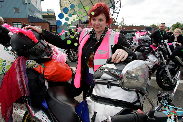Jane Souter with a pile of stuff getting ready for the Killie Bikers go on a run for Cancer Charity bike run leaving from Rugby Park,..120 bikers in pink bras and vests are setting off on a four-day ride around Scotland. The male bikers will all be wearing specially decorated bras over their leathers along with feather boas and wigs. The women will be wearing pink high visibility vests and helmet sporting pink mohawks during the ride.  . .Picture: Alistair Mulhearn/Universal News And Sport (Scotland). 1 June 2012