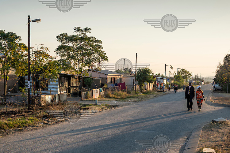 The sun sets in Marikana, a town surrounded by gold and platinum mines.