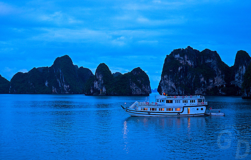 Hạ Long Bay, in northeast Vietnam, is known for its emerald waters and thousands of towering limestone islands topped by rain-forests. Junk boat tours and sea kayak expeditions take visitors past islands named for their shapes.