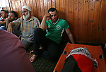 A relative mourns next to the body of 18-month-old Palestinian baby Ali Dawabsheh, who was killed after his family's house was set on fire in a suspected attack by Jewish extremists in Duma village near the West Bank city of Nablus July 31, 2015. Suspected Jewish attackers torched a Palestinian home in the occupied West Bank on Friday, killing an 18-month-old toddler and seriously injuring three other family members, an act that Israel's prime minister described as terrorism. Photo by Ahmad Talat
