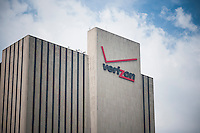 The Verizon building, now known as Intergate Manhattan, but with the iconic Verizon sign on top, in Lower Manhattan in New York on Tuesday, May 12, 2015. Verizon Communications announced that it will acquire AOL for approximately $4.4 billion pending regulator approval. (© Richard B. Levine)
