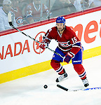 26 October 2009: Montreal Canadiens' center Glen Metropolit keep his eye on a flying puck during a game against the New York Islanders at the Bell Centre in Montreal, Quebec, Canada. The Canadiens defeated the Islanders 3-2 in sudden death overtime for their 4th consecutive win. Mandatory Credit: Ed Wolfstein Photo