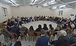 Members of an international ecumenical delegation listen to displaced Christian young people in Ankawa on January 23, 2017, during the group's visit to northern Iraq's Kurdistan region. The delegation was sponsored by the World Council of Churches. The meeting took place in the Mar Shmoni Syriac Catholic Church.