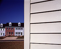 abstract design pattern residential row homes close up aluminum siding