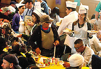 Parishioner Maria Shriver serves guests during the 32nd Annual Thanksgiving Dinner & Clothing Boutique at St. Monica Catholic Church on Wednesday, November 23, 2011.