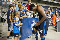 Sheanon Williams of the Philadelphia Union signs his jersey for a fan after a match between Aston Villa FC and Philadelphia Union at PPL Park in Chester, Pennsylvania, USA on Wednesday July 18, 2012. (photo - Mat Boyle)