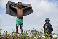 A child stands at the edge of the Kibati camp for displaced people, where thousands have fled to after renewed fighting in the region.