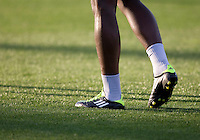 A picture of Seattle Sounders' player's legs and shoes walking on the field during practice before the game against the Earthquakes at Buck Shaw Stadium in Santa Clara, California on April 2nd, 2011.   San Jose Earthquakes and Seattle Sounders are tied 2-2.