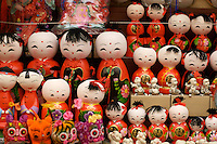 series of red chinese dolls at local market in beijing