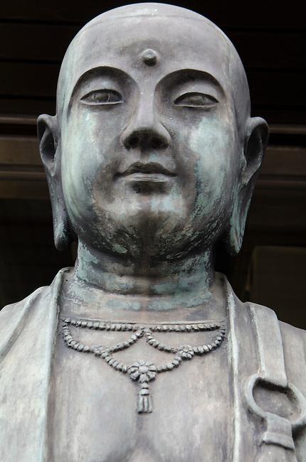 Japanese Buddha statue portrait with center eye