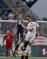 Second half substitute New England Revolution forward Zak Boggs (33) and Philadelphia Union forward Carlos Ruiz (20) battle for head ball. In a Major League Soccer (MLS) match, the Philadelphia Union defeated the New England Revolution, 3-0, at Gillette Stadium on July 17, 2011.