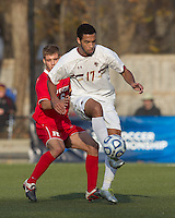 Boston College forward Charlie Rugg (17) controls the ball as Rutgers University defender Paulie Calafiore (16) pressures. Rutgers University defeated Boston College in penalty kicks after two overtime periods in NCAA Division I tournament action, at Newton Campus Field, November 20, 2011.