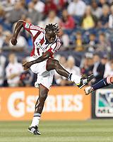 Chivas USA midfielder Shalrie Joseph (18) follows through on a shot. In a Major League Soccer (MLS) match, the New England Revolution tied Chivas USA, 3-3, at Gillette Stadium on August 29, 2012.