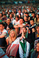 Moscow, Russia, 01/07/2012..An Italian fan prays in the Euro 2012 Fan Zone in Gorky Park, as Spain beat Italy 4-0 in the final of the soccer championship.