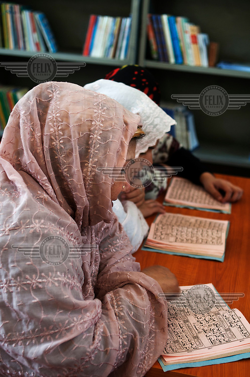 Prisoners read the Qur'an at Herat Women's Prison.