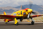 "Mike Brown's colorful Hawker built Sea Fury ""September Pops"" is taxied along the ramp at Stead Field, Nevada. The British built aircraft was originally delivered to the German Air Force in 1959 and was brought to the United States in 1985. It was re-built in 1997 and has raced at the Reno Air Races regularly since then. Photographed 09/07"