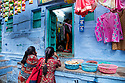 India, Jodhpur, Blue City, Historical City, Rajasthani women in front of store