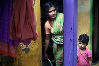 Though the residents of Yashwant Nagar in the Bandra suburb of Mumbai live in a congested neighborhood, they enjoy security of tenure and benefit from a strong civic sense - the result of a long-established community living in the area. Yashwant Nagar is about to be demolished to make way for a new housing development that will accomodate exisitng residents. The municipal water supply in Yashwant Nagar is confined to a few hours in the early morning during which residents must collect and store water for all their daily needs...The BMC (Brihanmumbai Municipal Corporation) uses the UNDP-devised Human Development Index (HDI) as a measure by which to allocate resources. ..Using parameters like population, literacy rate and infant mortality, and ranking wards in the order of performance, the BMC apportions funds to areas with lower education and higher mortality rates. The BMC also encourages the participation of Mumbai's citizens in the monitoring of education and health projects...Photo: Tom Pietrasik.Mumbai, India.September 8th 2010