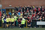 Supporters of Irish club Bohemians cheering their team onto the filed after half-time at Park Hall Stadium, Oswestry during their team's Champions League 2nd qualifying round 2nd leg game away to The New Saints. Despite leading 1-0 from the first leg, the Dublin club went out following their 4-0 defeat by the Welsh champions. The match was the first-ever Champions League match in the UK played on an artificial pitch and was staged at the Welsh Premier League's ground which was located over the border in England.