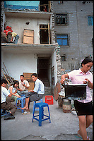 Fengdu, China, August 2003.Inhabitants in. the old city of Fengdu, already half-destroyed to allow the Three Gorges Dam project to be completed.