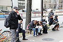 March 11, 2011, Tokyo, Japan - Concerned office workers and pedestrians try to make calls on jammed cellphone networks following aftereffects that shook the Tokyo Metropolitan Area on Friday, March 11, 2011. A powerful earthquake with a magunitute of 8.9 struck Miyagi prefecture, northern Japan, causing Tsunami and damages in wide area in northern prefectures. (Photo by Akihiro Sugimoto/AFLO) [1080] -mis-