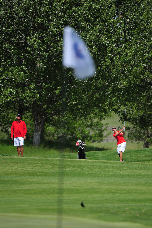 April 17, 2012; Hollister, CA, USA; Seattle Redhawks women's golf coach Don Rasmussen (left) and golfer Caitlin McCleary (right) during the WCC Golf Championships at San Juan Oaks Golf Club.