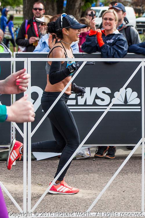 53-year-old Heidi Lozano, moments before she crossed the finish line, winning the women's Colfax Marathon.
