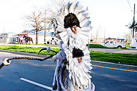 "Ruben Jones, ""flag boy"", and the rest of the Golden Comanches Mardi Gras Indians parade in the Treme neighborhood of New Orleans on February 28, 2006."