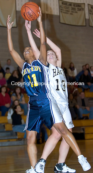 BEACON FALLS, CT- 08 DEC 06- 120806JT10- <br /> Kennedy's Devondra Riddick and Woodland's Chrissy Witham battle for the ball during Friday's game at Woodland. <br /> Josalee Thrift Republican-American