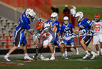 Chris LaPierre (44) of Virginia fights for the ball with Tom Montelli (11) and Steve Schoeffel (20) of Duke during the ACC men's lacrosse tournament semifinals in College Park, MD.  Virginia defeated Duke, 16-12.