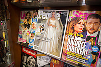 People magazine featuring the wedding of Angelina Jolie and Brad Pitt is seen on a newsstand with other celebrity mags in New York on Wednesday, September 3, 2014. People is reported to have paid almost $2 million for the U.S. rights with Hello buying the European rights. In 2008 photos of the couple's twin children went for $11 million. (© Richard B. Levine)