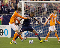 New England Revolution forward Khano Smith (18) attempts to dribble under close pressure by Houston Dynamo defender Bobby Boswell (32). The New England Revolution defeated Houston Dynamo, 1-0, at Gillette Stadium on August 14, 2010.