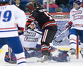 Mike McLaughlin (Northeastern - 18) ties the game at 2 just 2:44 into the third period. - The visiting Northeastern University Huskies defeated the University of Massachusetts-Lowell River Hawks 3-2 with 14 seconds remaining in overtime on Friday, February 11, 2011, at Tsongas Arena in Lowelll, Massachusetts.