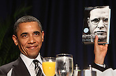 United States President Barack Obama shows a book given to him by Author Eric Metaxas who was the keynote speaker at the National Prayer Breakfast in Washington, DC, February 2, 2012. .Credit: Chris Kleponis / Pool via CNP