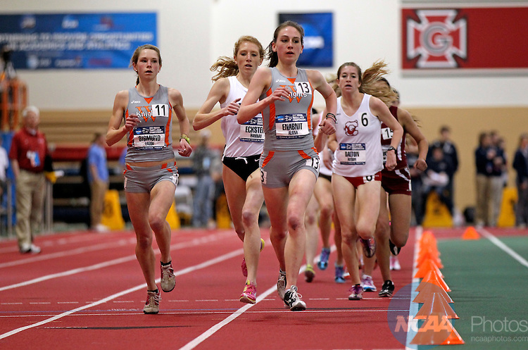10 MAR 2012:  Laura Sigmund (left) and team mate Alana Enabnit of Wartburg hold off a challenge from Hanna Eckstein of Johns Hopkins in the women's 5000 meter during the Division III Men's and Women's Indoor Track and Field Championship held at the Grinnell College Athletic Fieldhouse in Grinnell, IA.  Sigmund's winning time was 17:01.82  with Enabnit finished second in 17:12.98  Stephen Mally/NCAA Photos