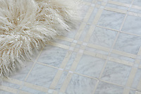McIntyre™, a stone mosaic shown in Carrara, Bianco Antico, and Heavenly Cream honed, is part of the Plaids and Ginghams Collection for New Ravenna Mosaics.