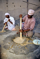 Mudhaireb (Mudayrib), Oman.  Man Stirring Harees, an Eid al-Adha Dish made of Wheat Soaked in water 4 Hours, then Cooked 12.