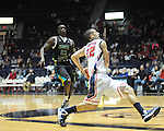 "Ole Miss's Marshall Henderson (22) vs. Coastal Carolina's Badou Diagne (23) at the C.M. ""Tad"" Smith Coliseum in Oxford, Miss. on Tuesday, November 13, 2012. (AP Photo/Oxford Eagle, Bruce Newman)"
